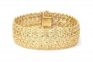 Een 18 krt brede gouden armband