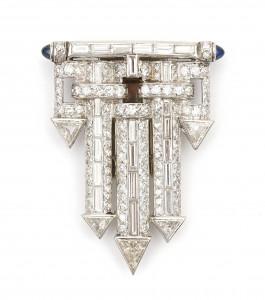 Een platina en 14 krt gouden Art Deco clip broche met diamant en saffier